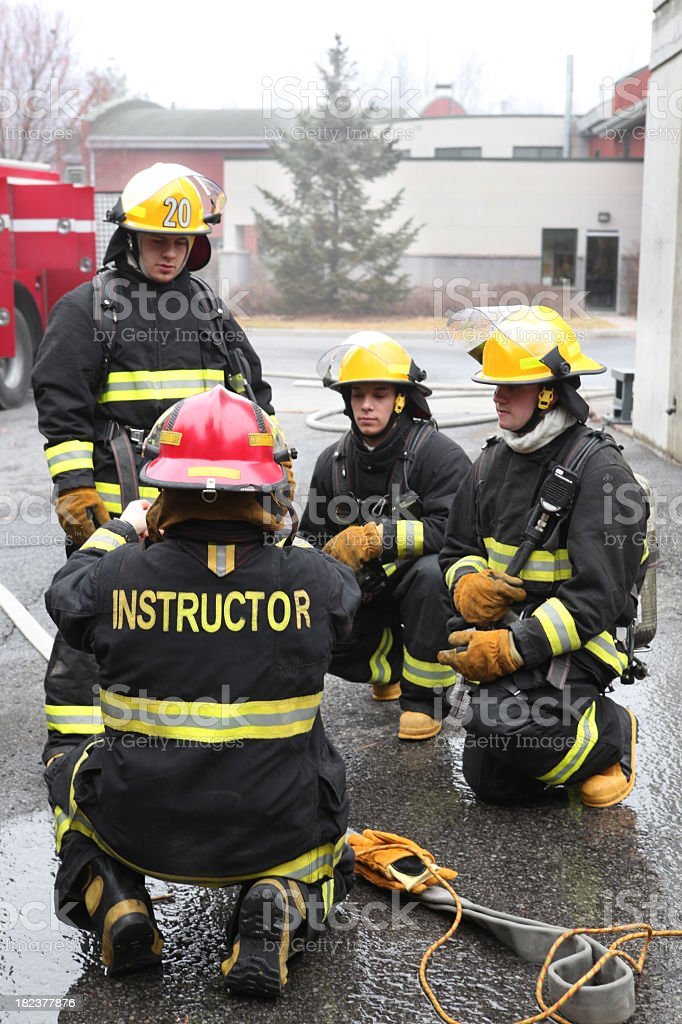 Firemen with instructor stock photo