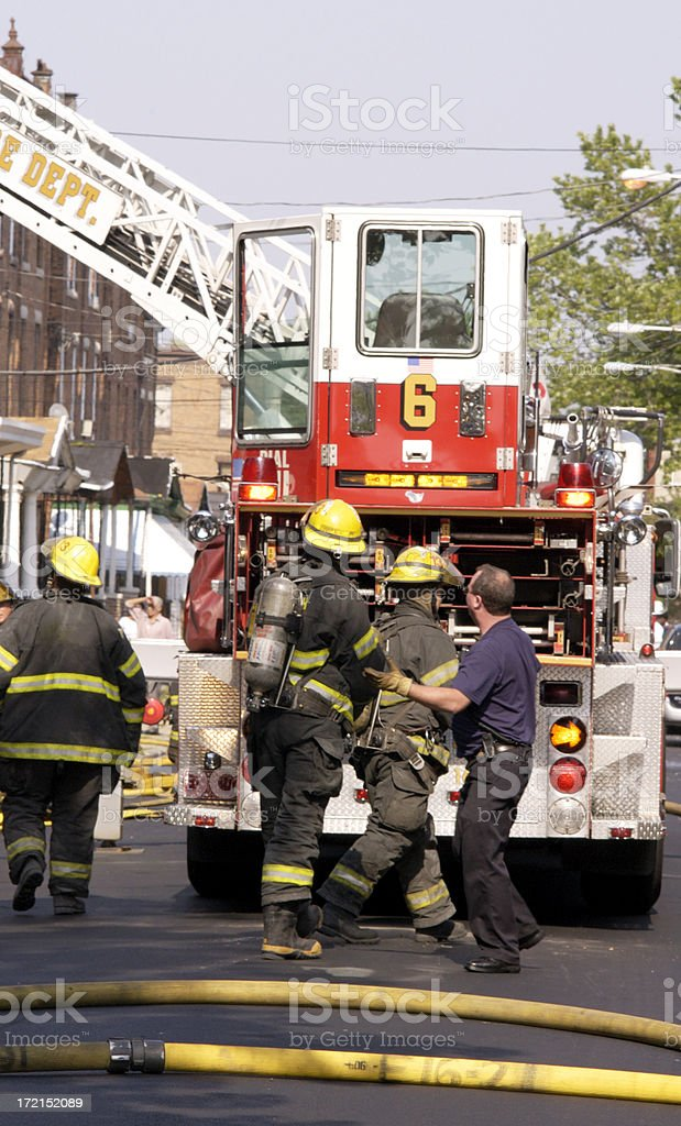 firemen with ladder truck royalty-free stock photo