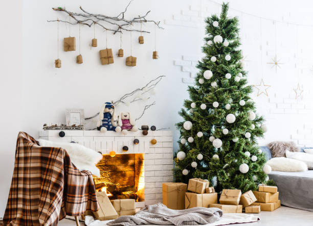Fireplace and Christmas tree with presents in living room Fireplace and Christmas tree with presents in living room christmas interior stock pictures, royalty-free photos & images