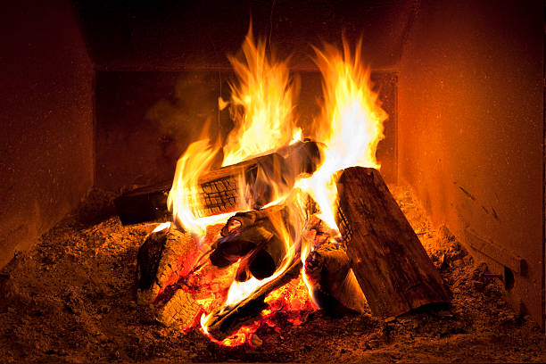 Fireplace flames in winter Log fire in a fire place log fire stock pictures, royalty-free photos & images