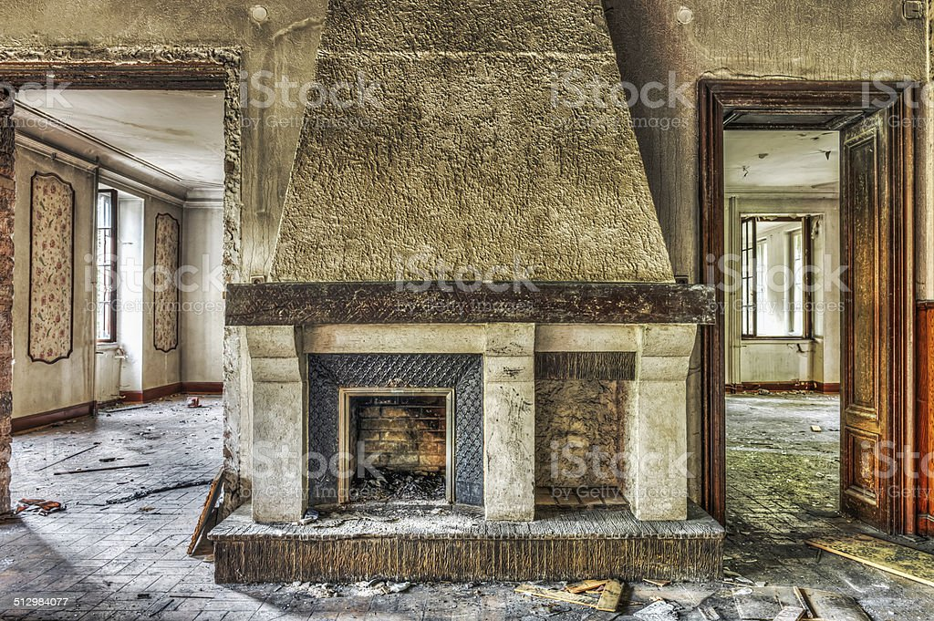 Fireplace in an abandoned manor stock photo