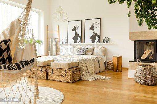 istock Fireplace in boho bedroom interior 961081592