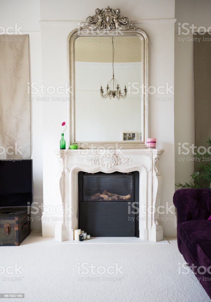 Fireplace in bright living room stock photo