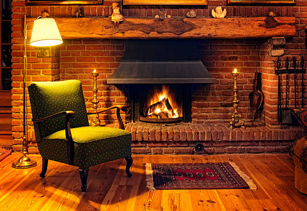 Fireplace Living room with fireplace log fire stock pictures, royalty-free photos & images