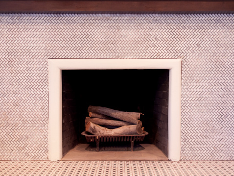 Tile fireplace with mantle and wood logs