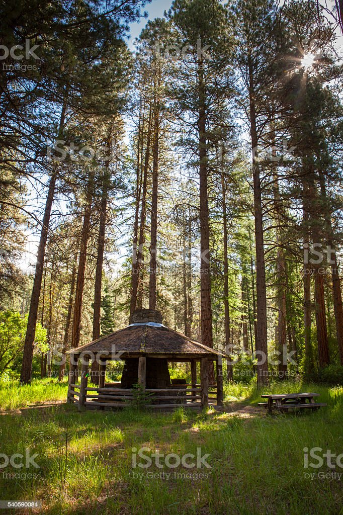 Fireplace shelter along the Metolius River in Oregon stock photo