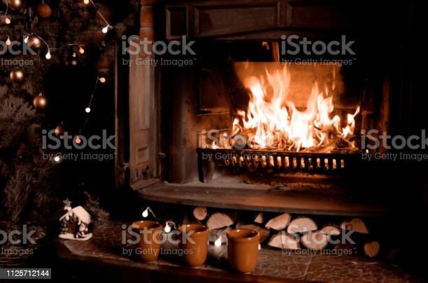 Fireplace with burning fire three cups and christmas treewarm home picture id1125712144?b=1&k=6&m=1125712144&s=612x612&h=zcxltpoefv1zhwivio5qee0hbgf 3pcfrehwa2vwlze=
