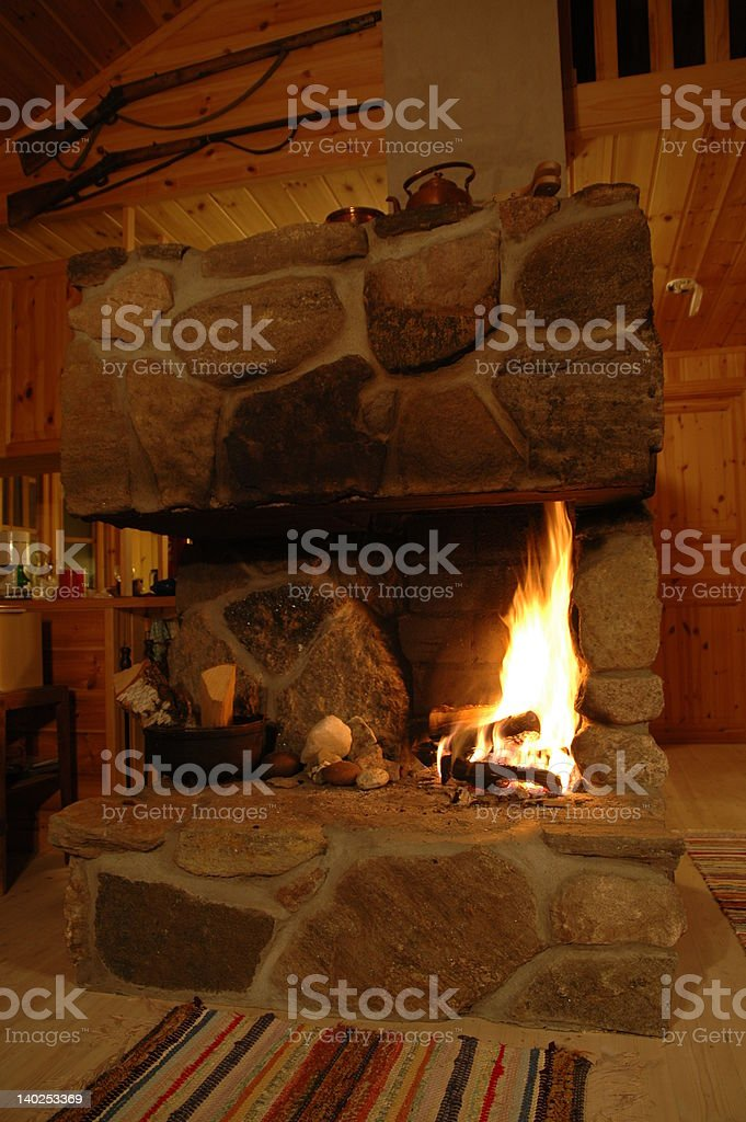 Fireplace with burning log fire royalty-free stock photo
