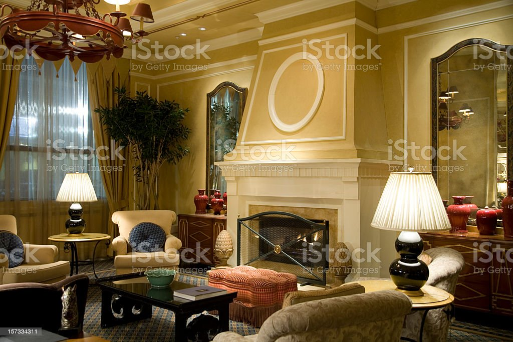 Fireplace with Comfy Chairs in Luxury Hotel Lobby Reception royalty-free stock photo