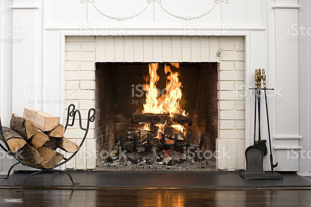 Fireplace with fire burning stock photo