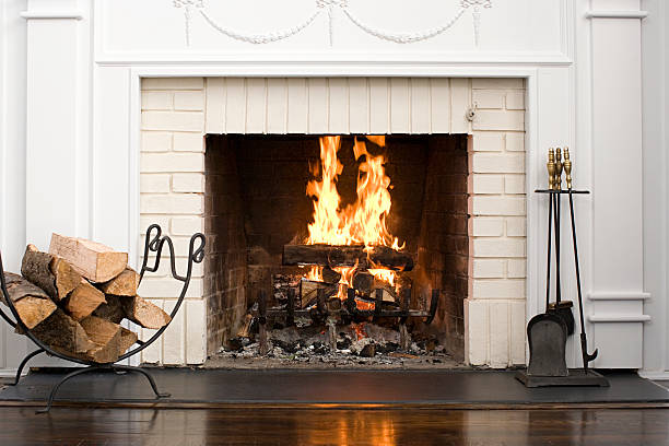 fireplace with fire burning - fireplace stockfoto's en -beelden