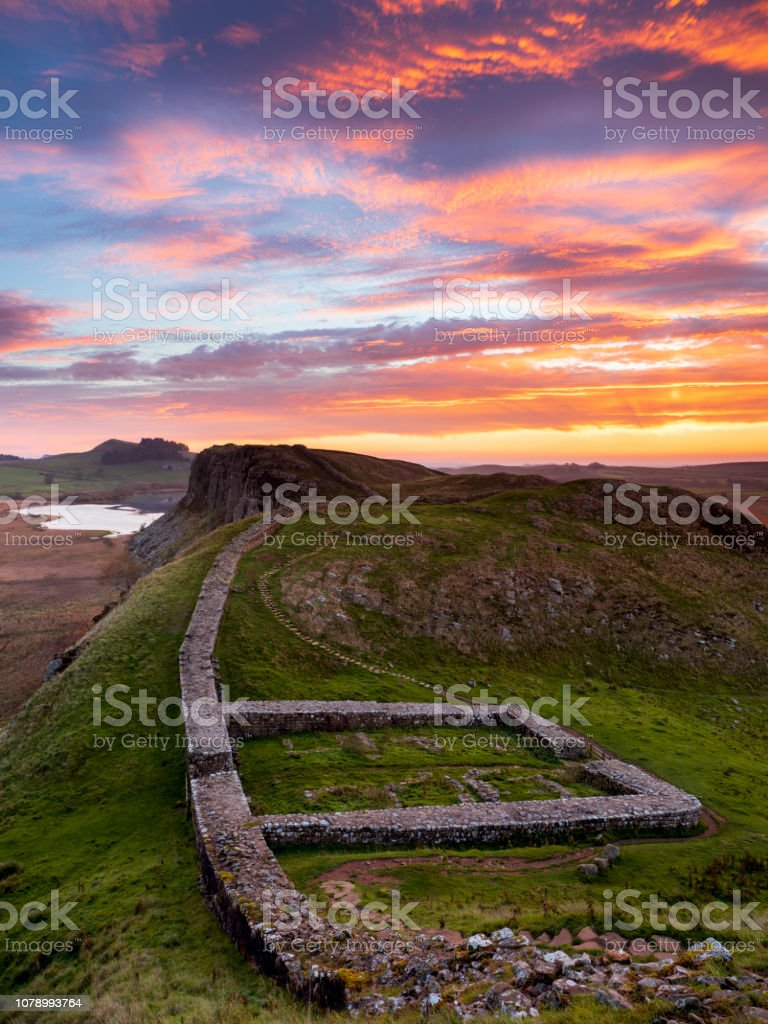 Firery sunrise over Milecastle 39 on Hadrian's Wall. stock photo