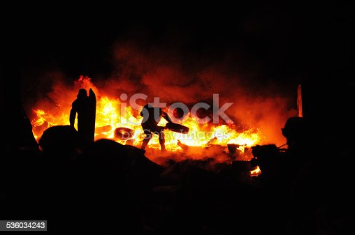 Protester burn tires to stop the riot police. Street fights in Kyiv, Ukraine. Ukraine crisis. Fires of a Revolution.