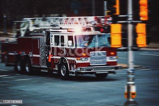 A firetruck speeds through an intersection.