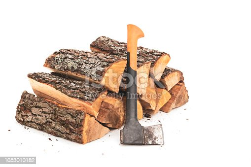 A stack of split firewood and axe on a white background