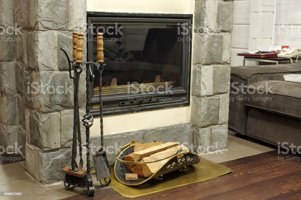 Firewood burns in the fireplace creating warmth and homeliness stock photo