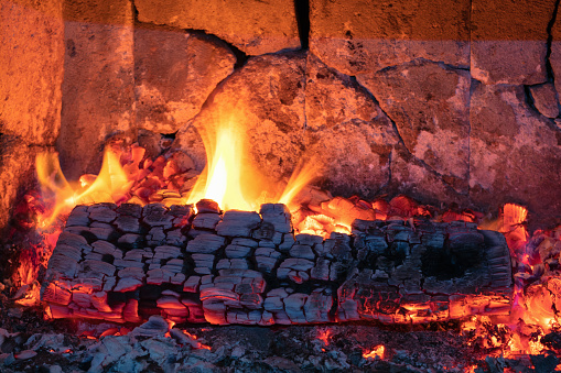 Firewood burns in the fireplace