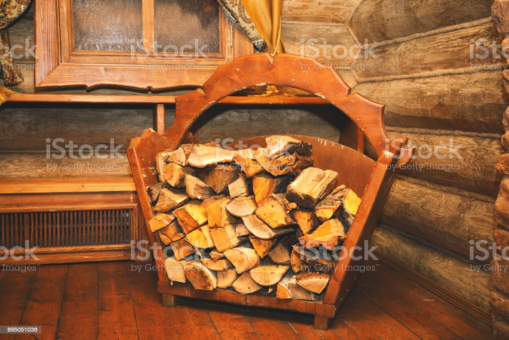 Firewood for firing oven, fireplace and bath. Interior of the premises in the Russian folk style - wooden log cabin stock photo