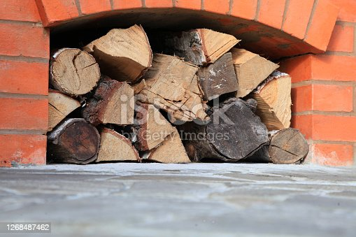 Firewood is built in brick komin of private village house