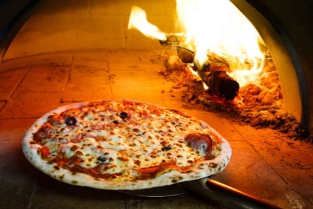 firewood oven pizza - pizzeria stock photos and pictures