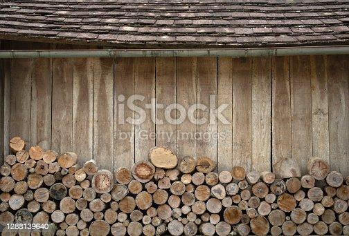 Firewood pile behing a wooden hut in Santa Catarina, Brazil.