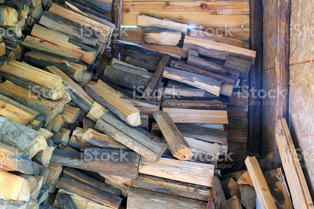 Firewood stack in a wooden shed stock photo