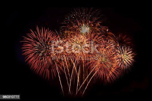 istock firework Abstract background,Fireworks light up the sky with dazzling display 980310772