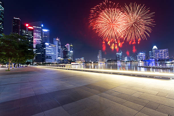 firework and night view of prosperous city stock photo