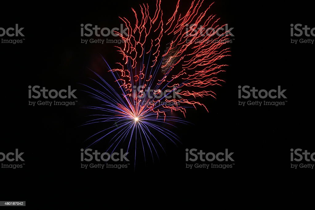 Firework Blasts - Red and Blue stock photo