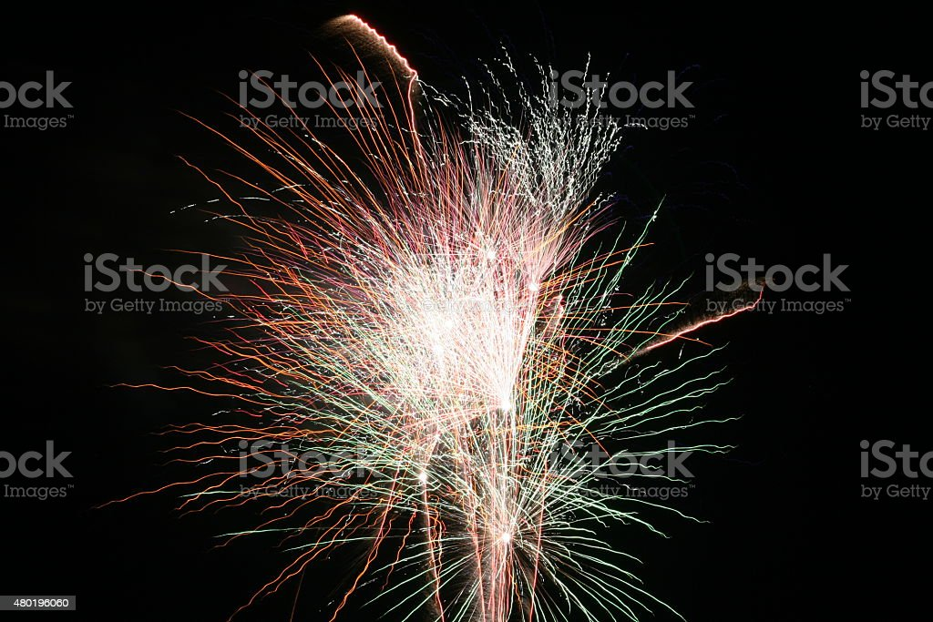 Firework Blasts - Red and Green stock photo