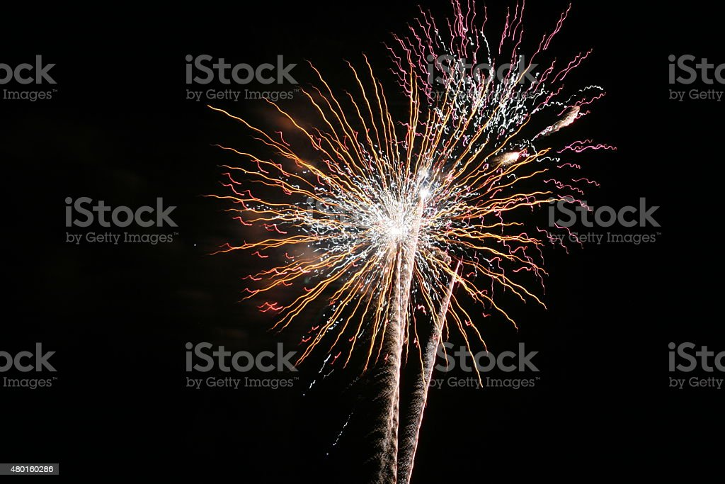 Firework Blasts - Yellow and Pink stock photo