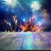 Firework Display Behind Wooden Floor For Celebration Events