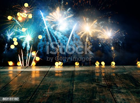istock Firework display behind wooden table 853151182