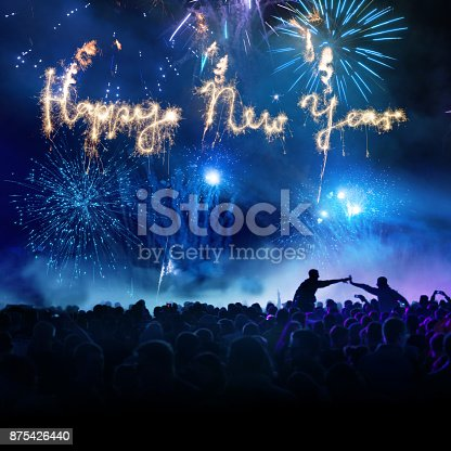 istock Firework Display With Celebrating People And Sparkler Happy New Year 875426440