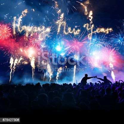 istock Firework Display With Celebrating People And Sparkler Happy New Year 875427308