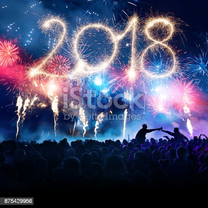 istock Firework Display With Celebrating People And Sparkler New Year 2018 875429956