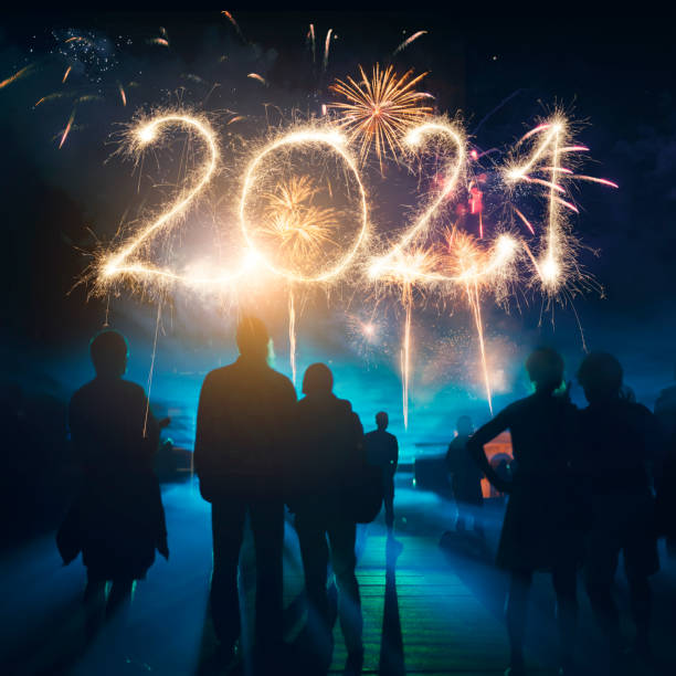 Firework Display With Celebrating People And Sparkler New Year 2021 stock photo