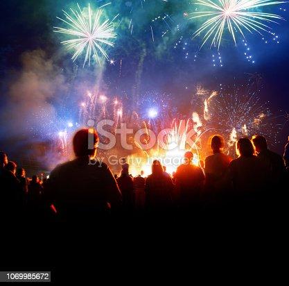 istock Firework Display With Celebrating People 1069985672