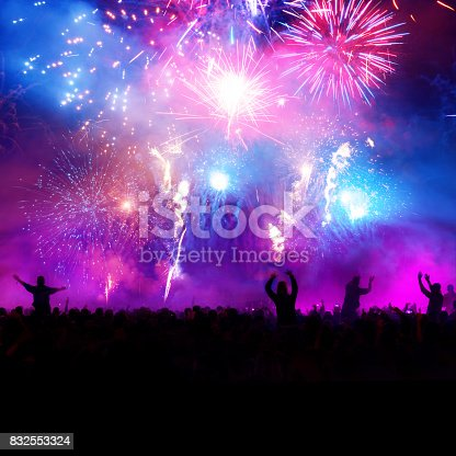 istock Firework Display With Celebrating People 832553324