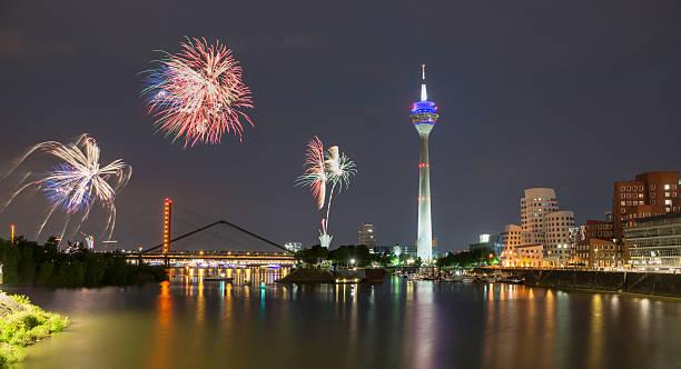 firework in dusseldorf media harbor. - silvester deutschland stock-fotos und bilder