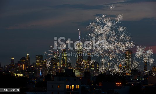 525385459 istock photo Firework over city at night with Fireworks over Manhattan 996133818