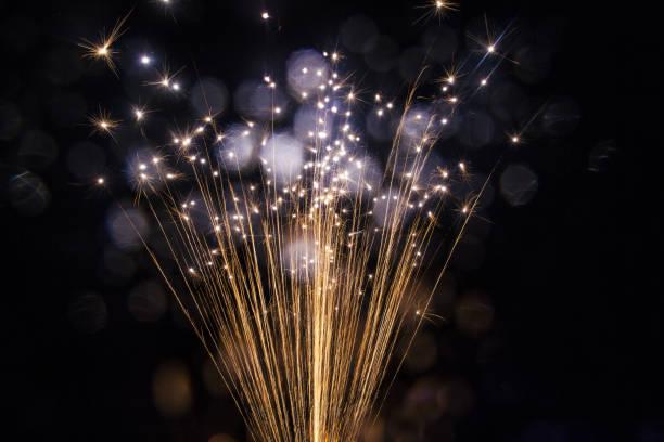 Firework Sparks against black background stock photo