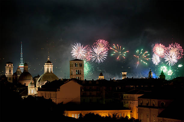 Fireworks above the roofs of Turin by night stock photo