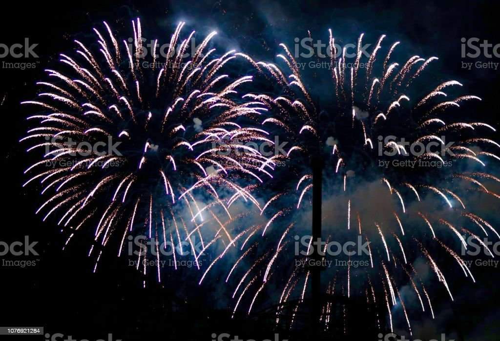Fireworks and amusement park stock photo
