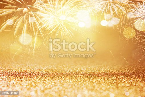 istock Fireworks and bokeh in New Year eve and space for text. Abstract background holiday. 823708948