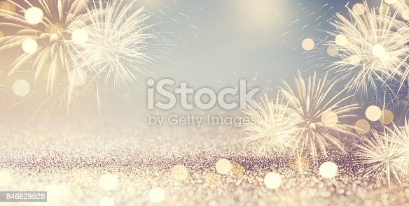 istock Fireworks and bokeh in New Year eve and space for text. Abstract background holiday. 846629528