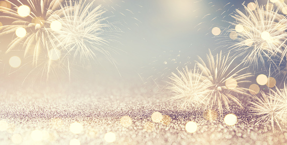 Vintage Gold and blue Fireworks and bokeh in New Year eve and space for text. Abstract background holiday.