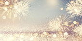 Fireworks and bokeh in New Year eve and space for text. Abstract background holiday.
