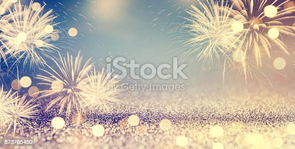 istock Fireworks and bokeh in New Year eve and space for text. Abstract background holiday. 873765450