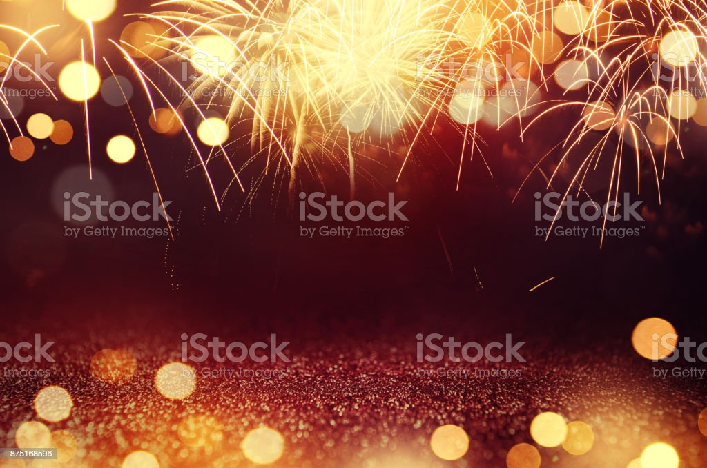 Fireworks and bokeh in New Year eve and space for text. Abstract background holiday. Red and gold Fireworks and bokeh in New Year eve and space for text. Abstract background holiday. 2018 Stock Photo